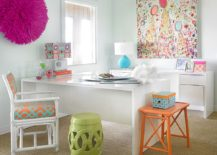 Decor and wall art adds color to the white home office