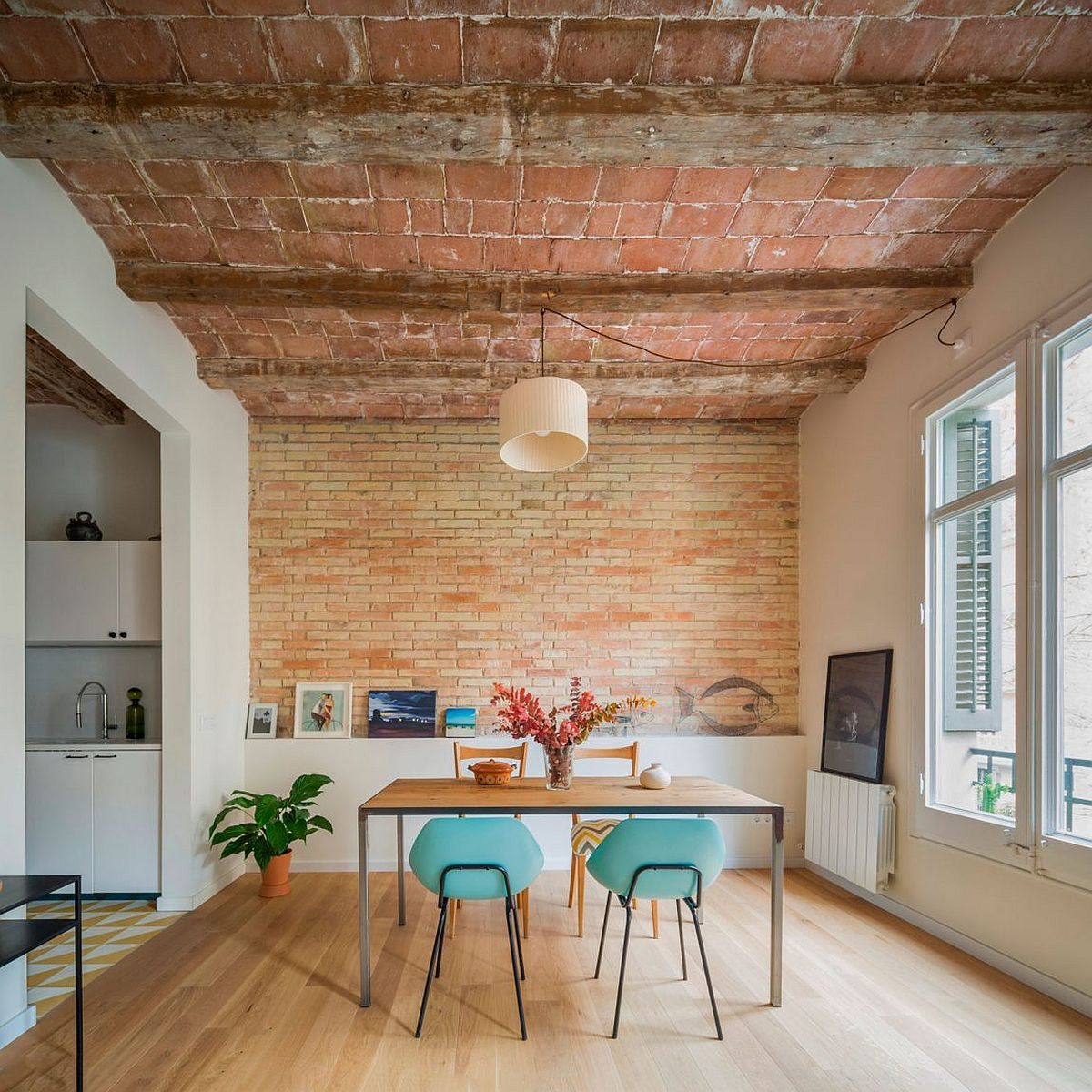 Dining room of renovated home in Barcelona with iconic chamfered corners