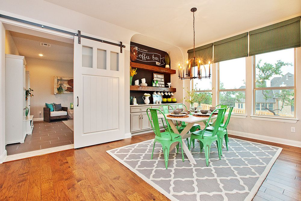 Dining room with bright green chairs, corner coffee station and sliding style barn door