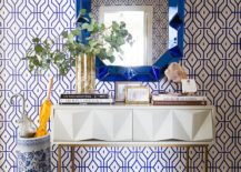 Entry of charming New York home with fabulous wallpaper, mirror and console