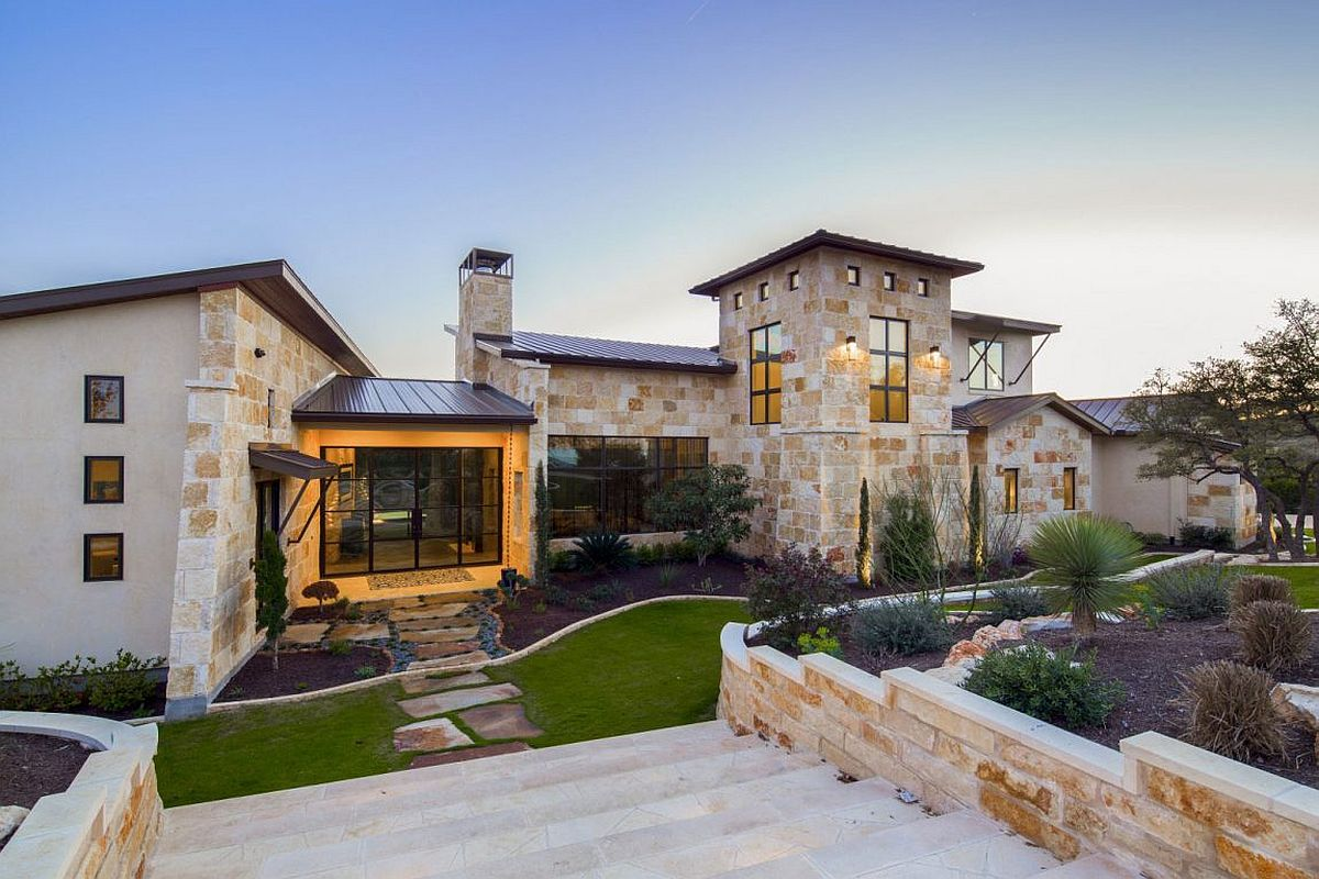 Entryway and stone walkway leading to the luxurious Texas home Musket Contemporary in Austin: A Blend of Rustic Beauty and Modern Finesse