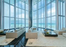 Expansive and awesome living room with glass walls and ocean views