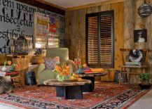 Exquisite eclectic livig room with pops of bright color and a dashing coffee table