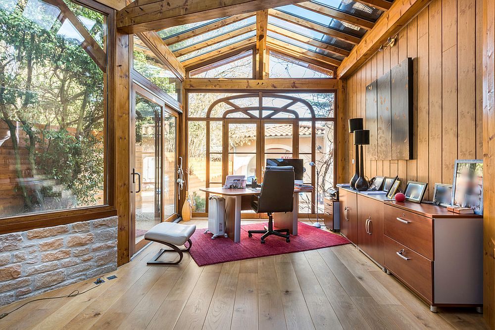 Exquisite rustic sunroom that doubles as a quiet home office [From: Alexandre Montagne - Photographe immobilier]