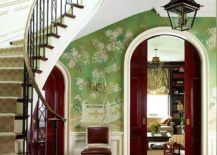 Exquisite wallpaper in green with floral pattern enlivens this entry room