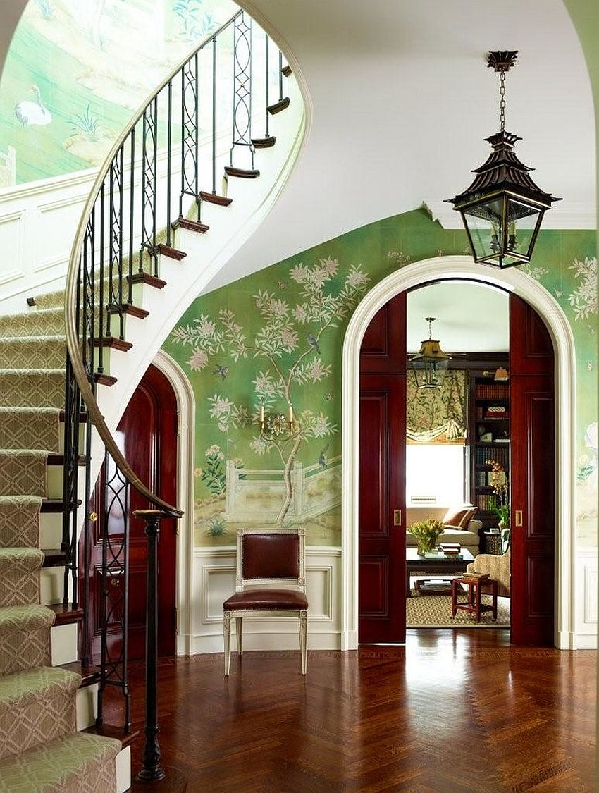 Exquisite hand-painted wallpaper in green with floral pattern enlivens this entry room [Design: Studio 511]