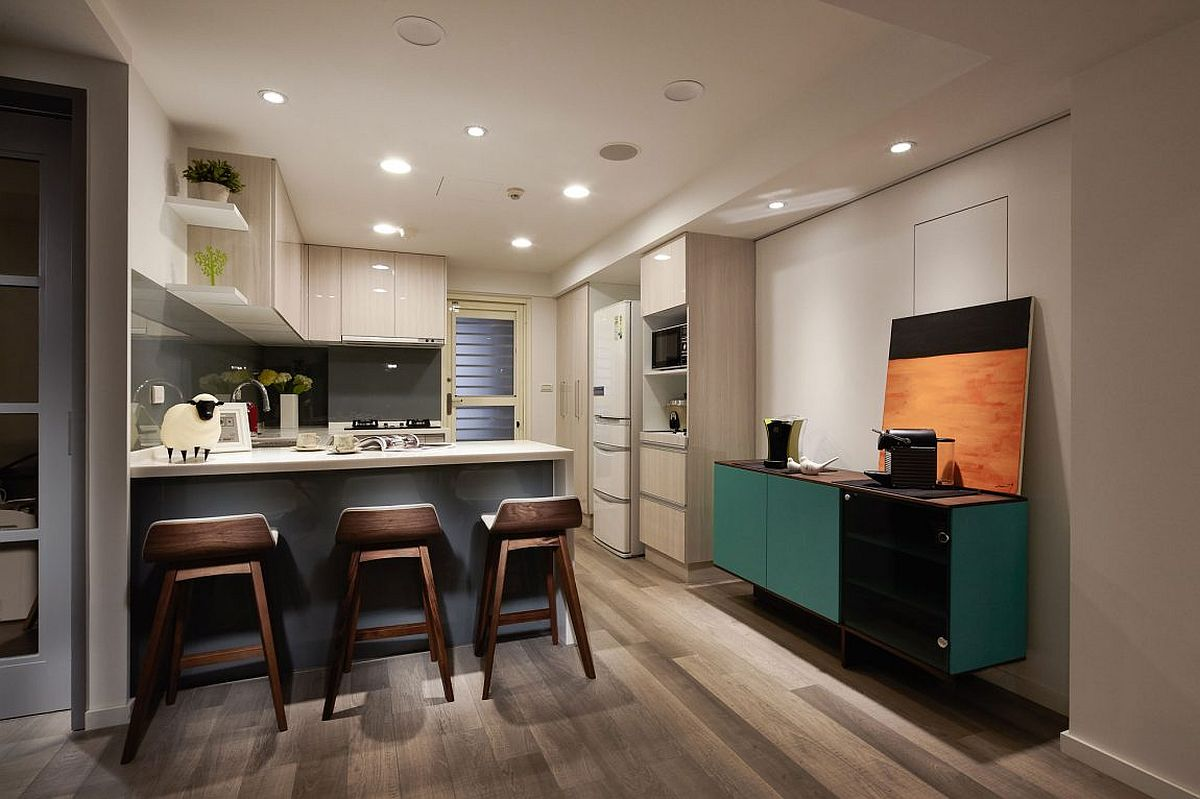 Fabulous credenza in teal adds color to the kitchen space
