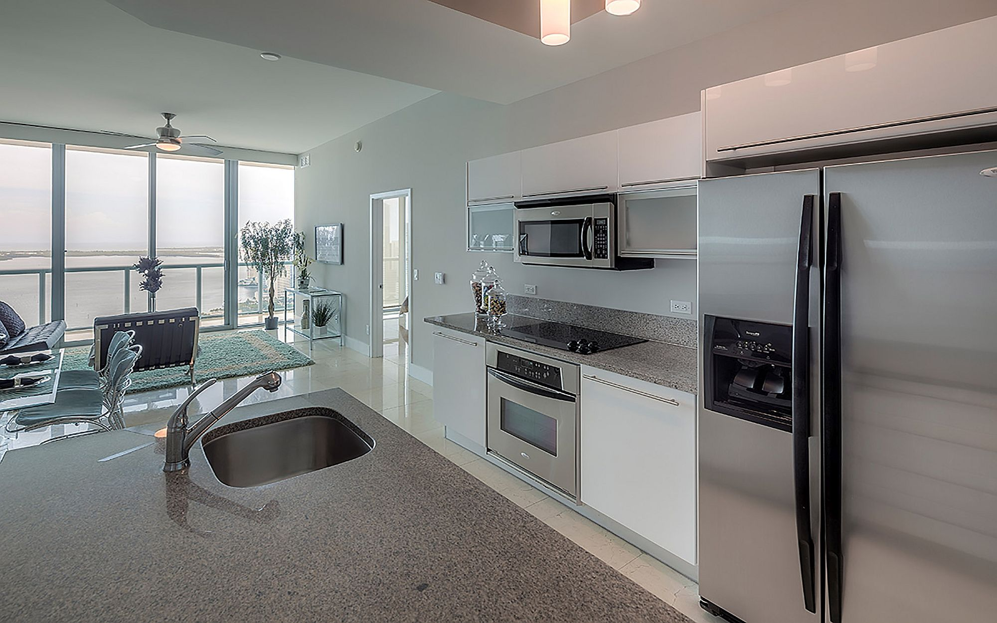Fabulous kitchen connected to the living area also offers water views