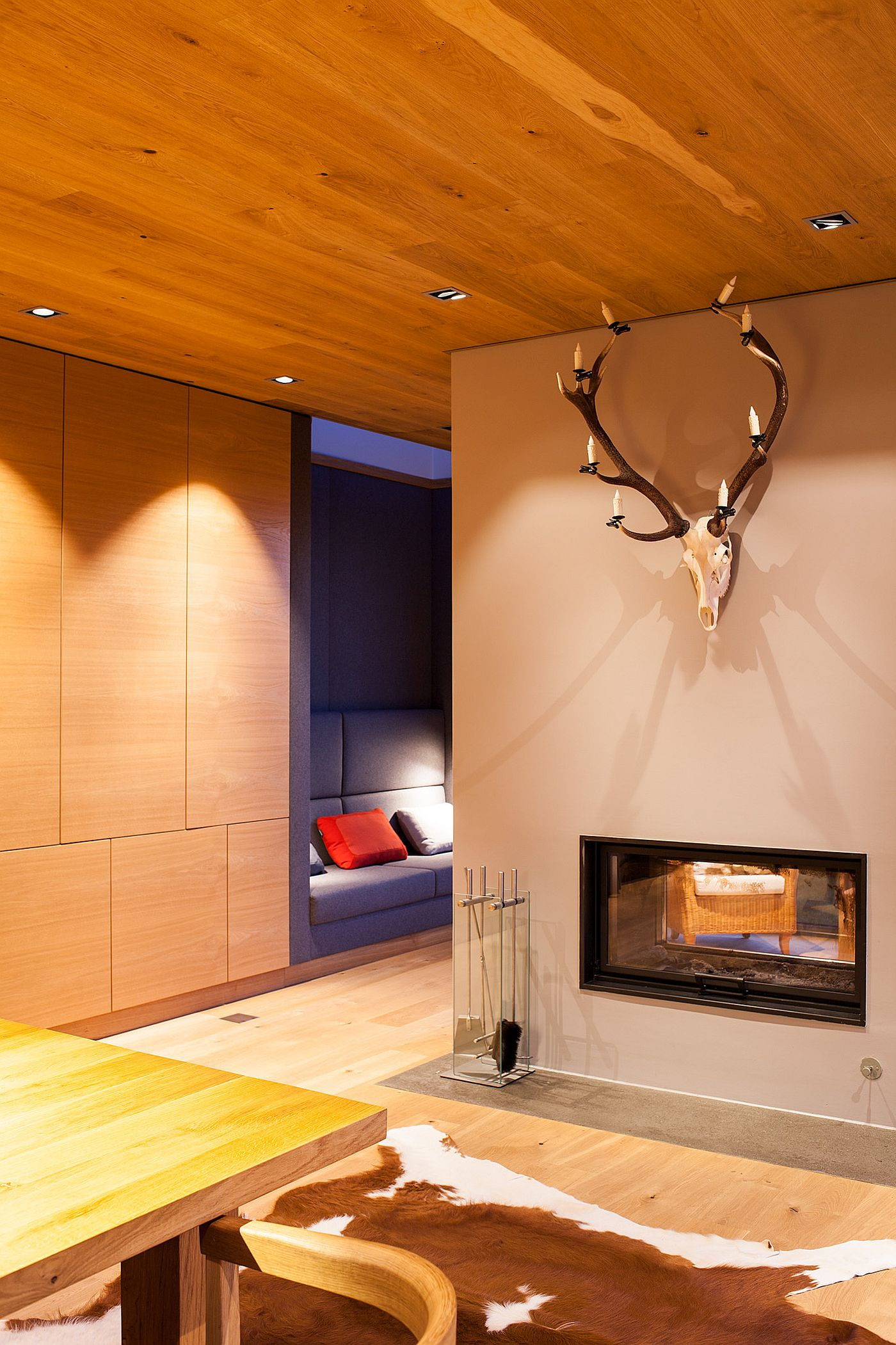 Fireplace and cozy upholstered niche inside the new extension