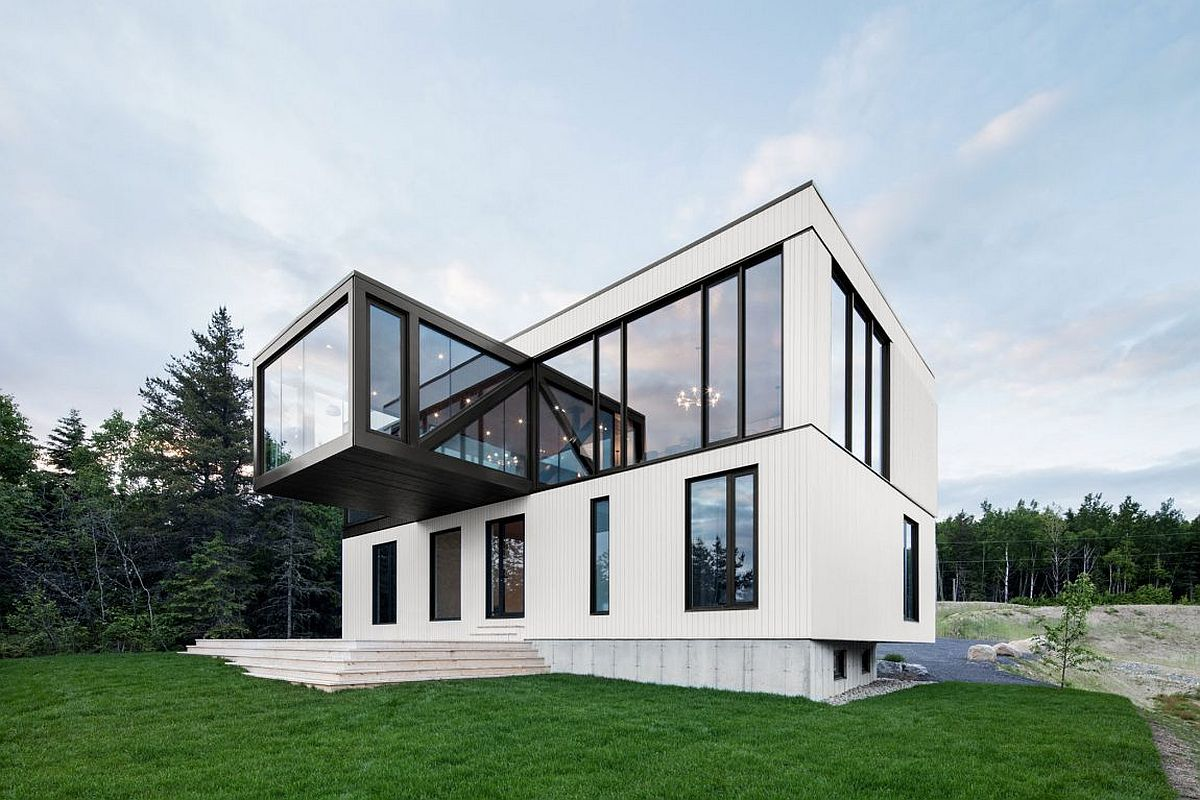 Floating overhang with glass walls houes the living space that offers 360 degree views of the landscape