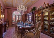 From ceiling medallions to gold accents everything about this dining room shouts out Victorian