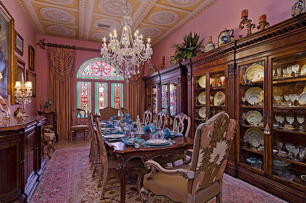 From ceiling medallions to gold accents everything about this dining room shouts out Victorian [Design: Certified Luxury Builders – Sarasota]