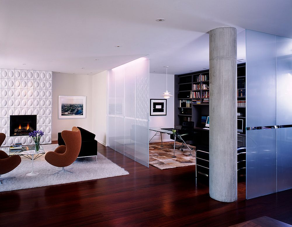 Frosted glass room divider separates the modern living room from the beautiful home office [Design: Morlen Sinoway Atelier]
