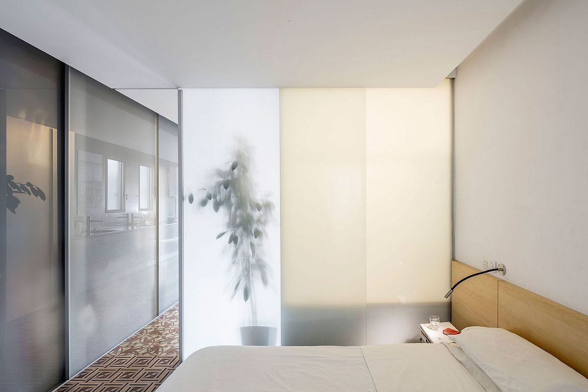 Glass doors and smart partitions create rooms within the open floor plan