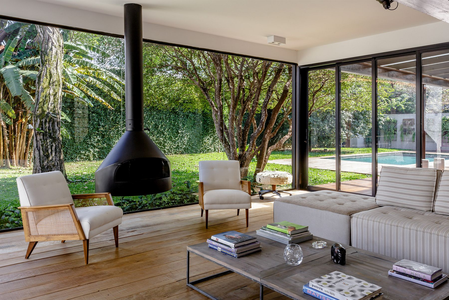 Glass walls and sliding glass doors bring the garden outside indoors