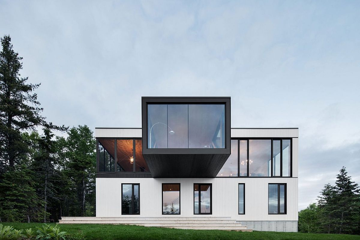 Glass walls of the top level of the home opens up the living area to the stunning view outside