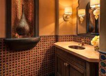 Gorgeous Mediterranean powder room in orange with wooden vanity 217x155 Cheerful Spunk: Enliven Your Powder Room with a Splash of Orange