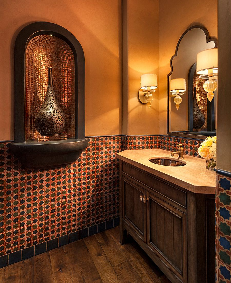Gorgeous Mediterranean powder room in orange with wooden vanity [Design: DesignARC]