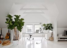 Gorgeous attic home office in white with indoor plants and plenty of freshness
