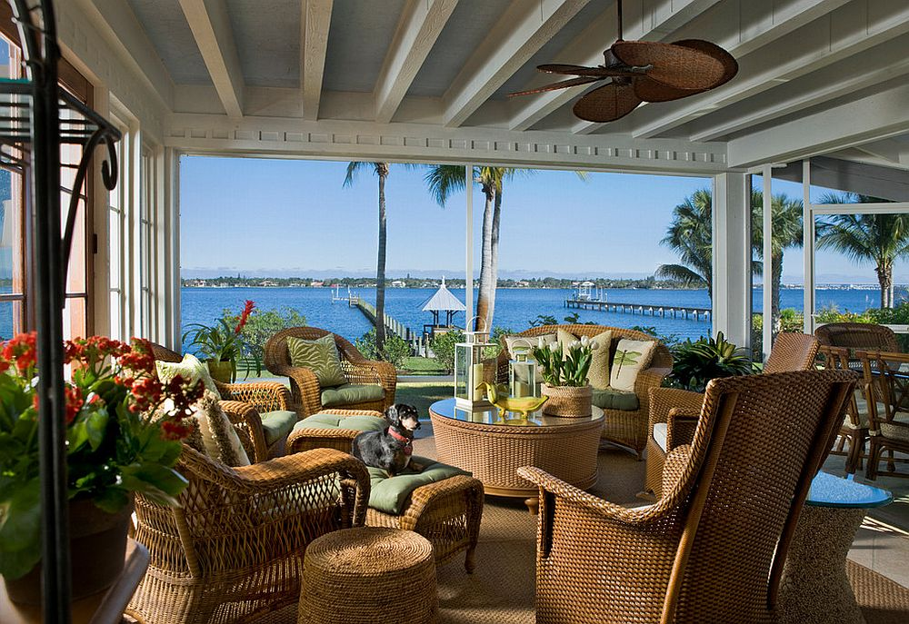 Gorgeous ceiling fan is an essential part of the tropical sunroom [Design: Dianne Davant and Associates]