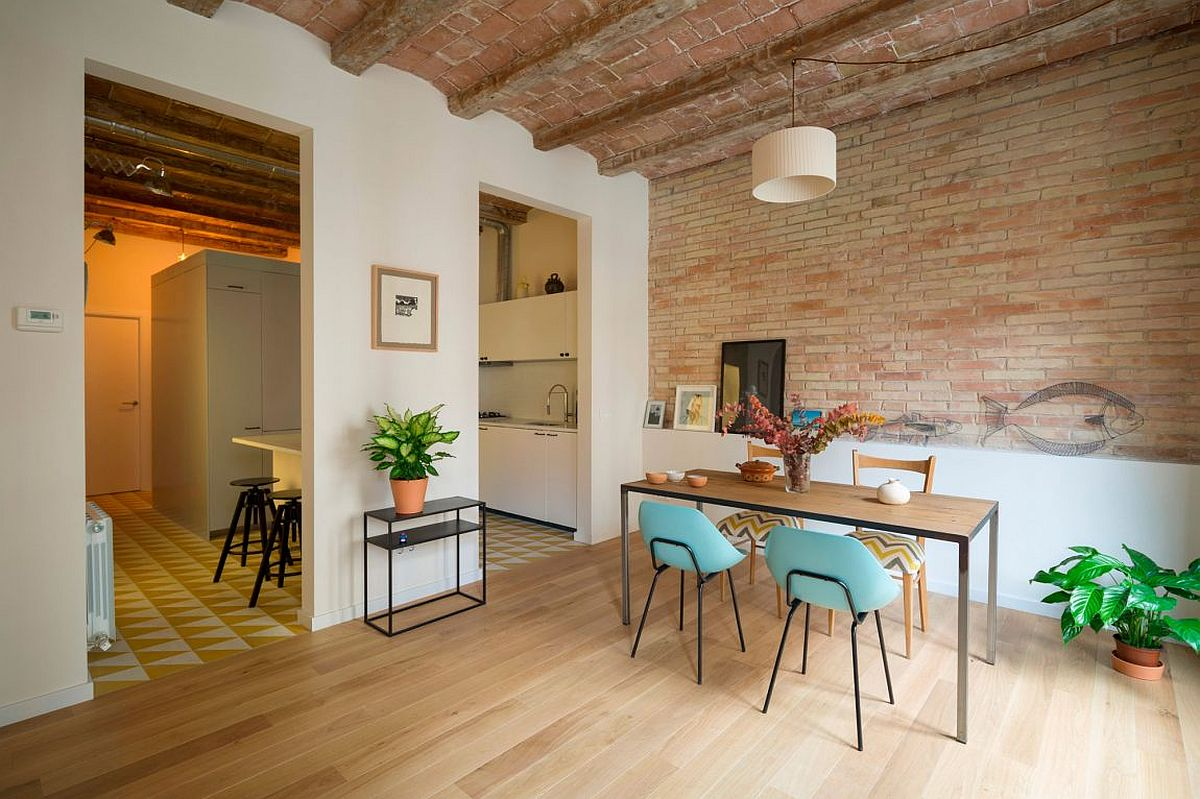 Gorgeous dining space with exposed brick walls and ample natural light