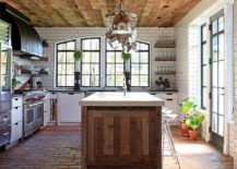 Gorgeous kitchen island draped in reclaimed wood