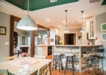 Gorgeous planks of reclaimed wood give the kitchen island and breakfast zone a unique character