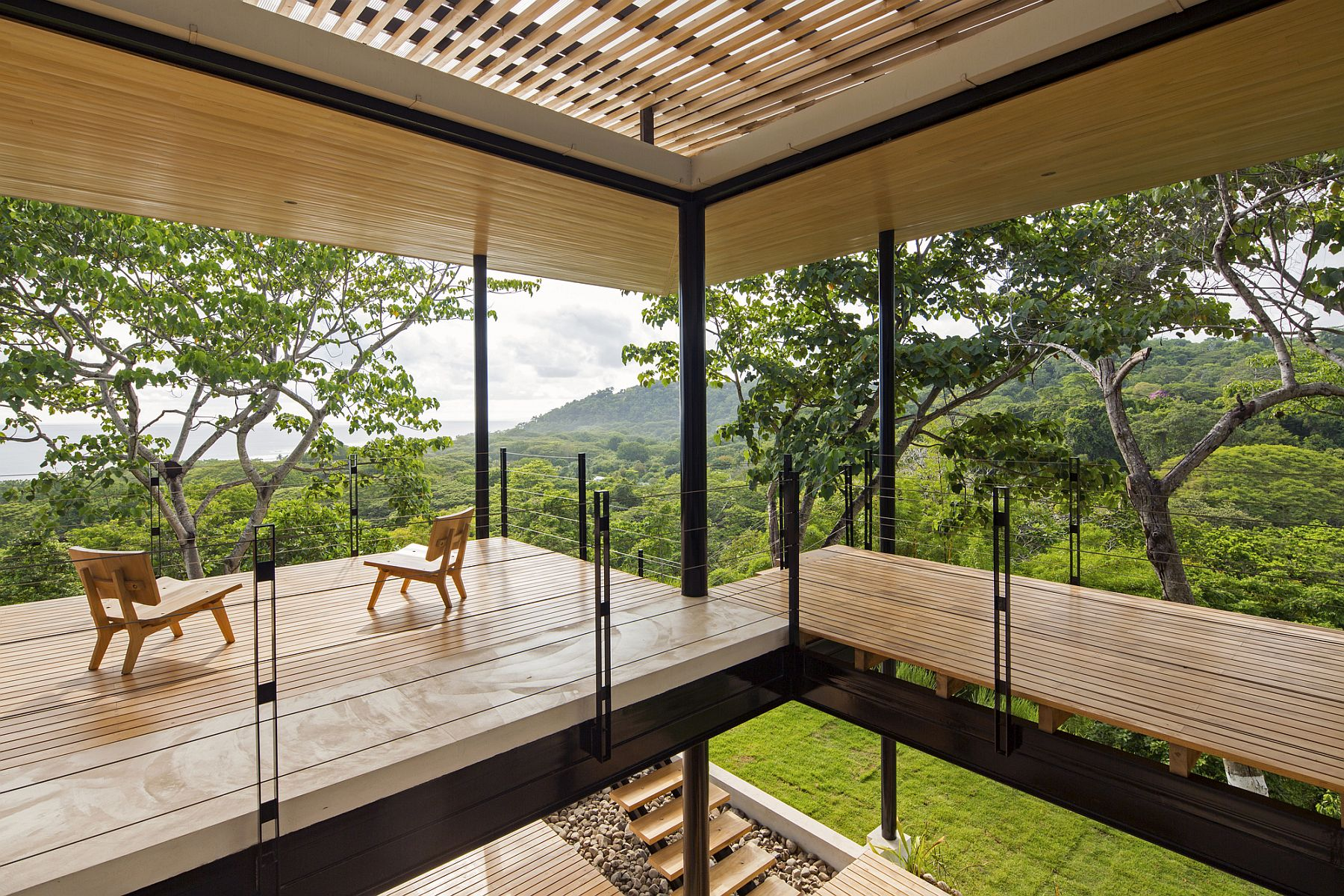 Gorgeous wooden terraces bring the forest scenery indoors