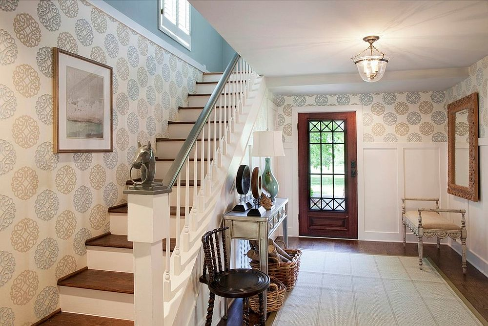 Graphic wallpaper and neutral color scheme links the entryway with the rest of the home [Design: Eric Ross Interiors, LLC]