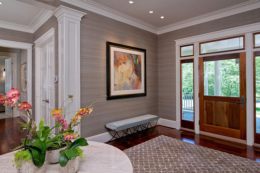 Grasscloth wallcovering adds color and textural beauty to the entryway [Design: L.S. Design]