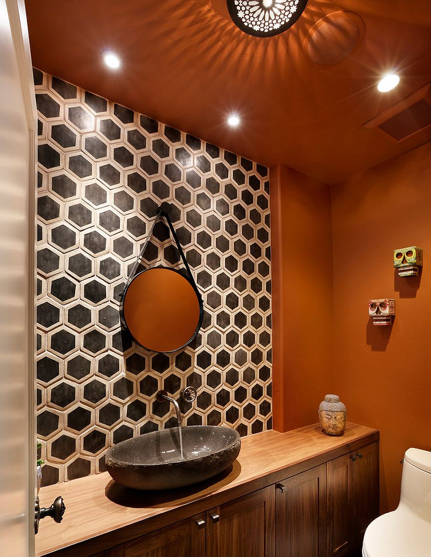 Hexagonal tile pattern brings geometric contrast to the powder room in orange [Design: TRG Architects]