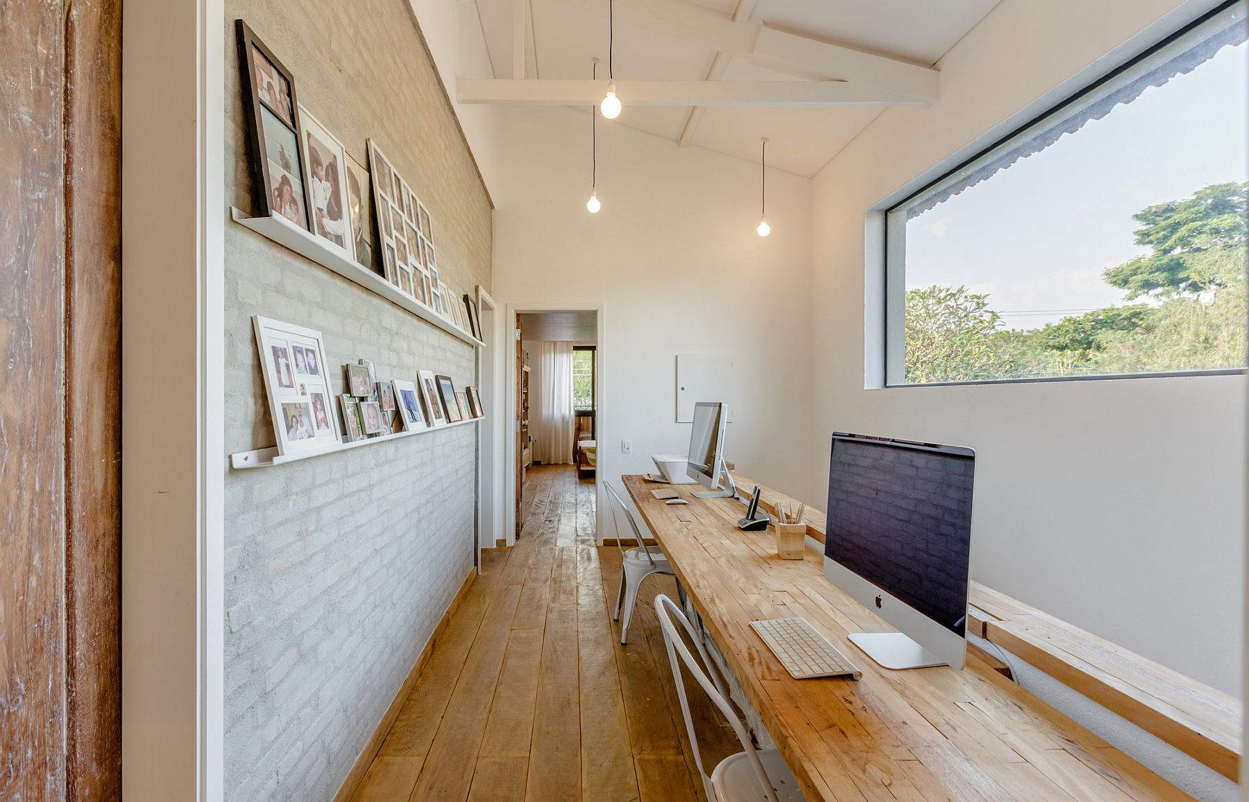 Home office with picture wall and a wonderful view