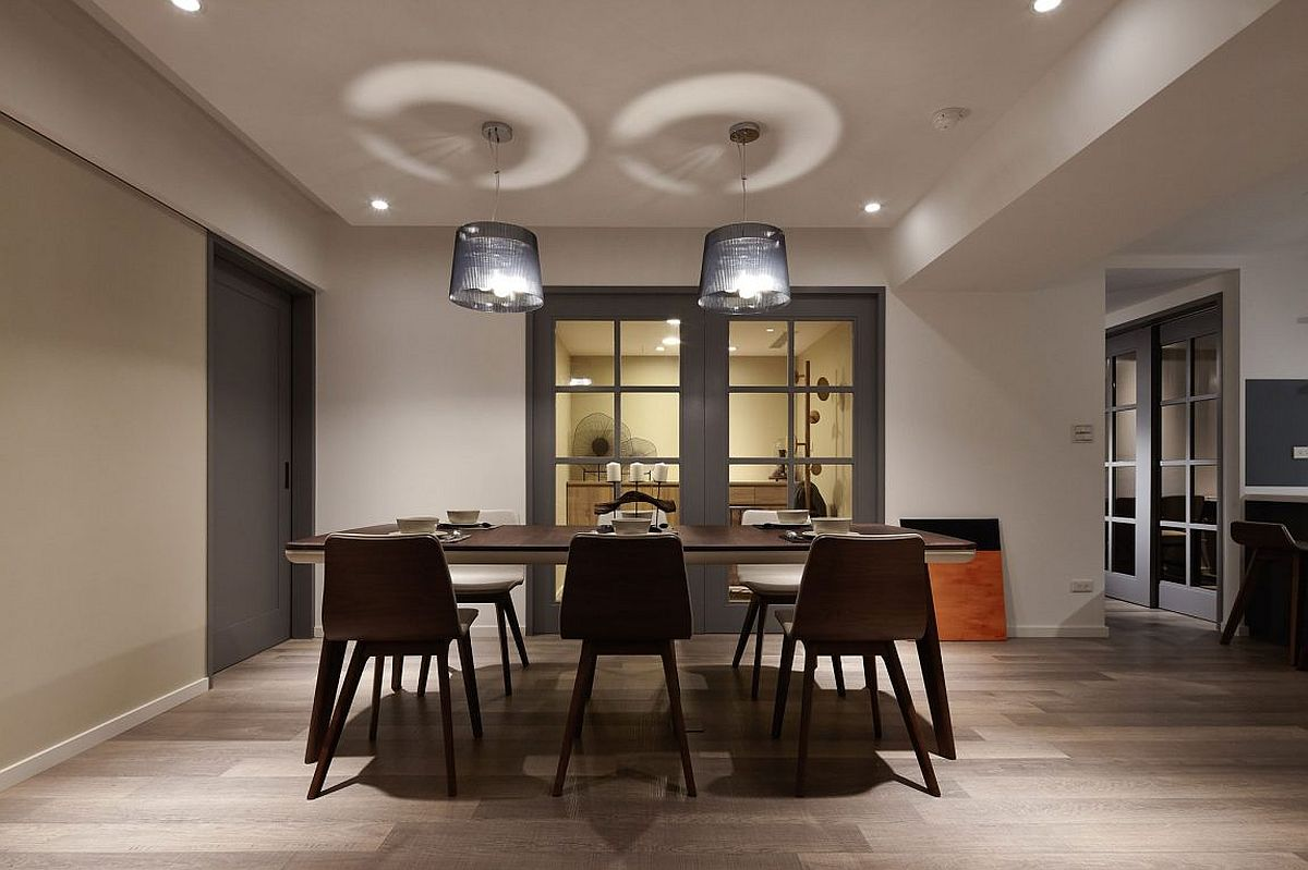 Dark Sophistication Thirty Year Old Apartment Embraces a  : Industrial modern style pendant lights for the dining room from www.decoist.com size 1200 x 799 jpeg 102kB