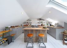 Industrial style attic kitchen in white with a woodsy island