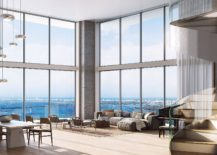 Interior of the apartment offers stunning views of city skyline thanks to floor-to-ceiling windows