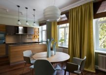Kitchen and dining room of the Kiev home with woodsy warmth