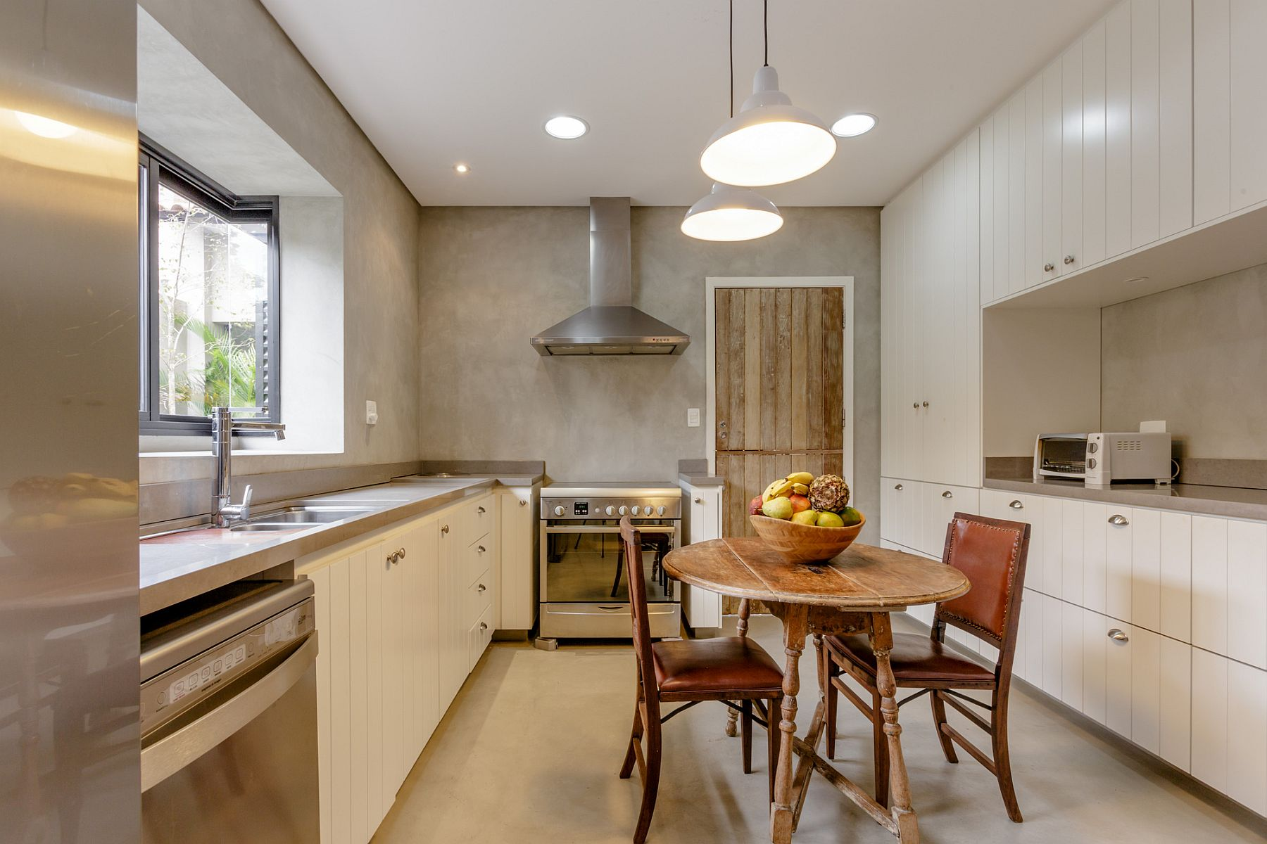 Kitchen with neutral color palette and cement walls
