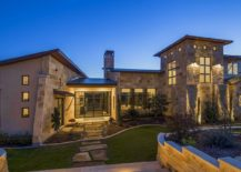 Landscape lighting adds to the elegance of the modern rustic Texas home
