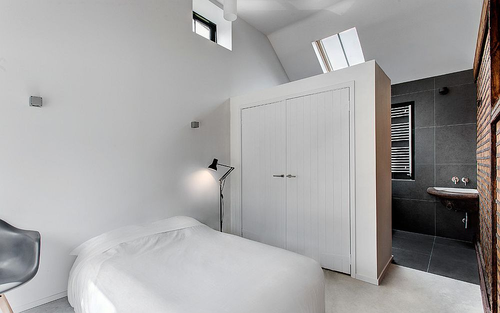 Large wardrobe serves as a room divider between the attic bedroom and bathroom [Design: AR Design Studio Ltd]