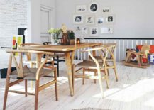 Light-filled Scandinavian dining area with wishbone chairs and wooden table