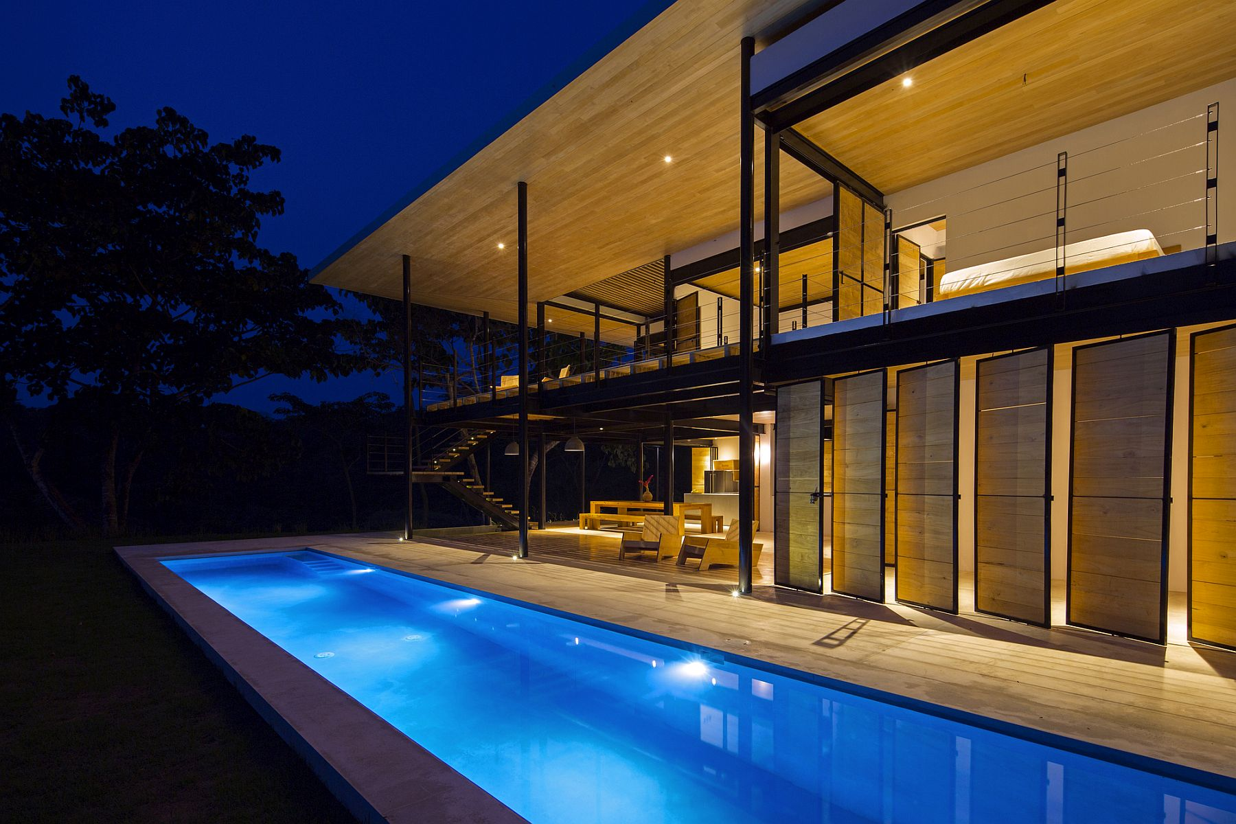 Lighting showcases the open and breezy Costa Rican home in a completely different light!