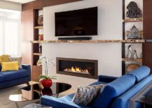 Live edge shelves and mantle transform this contemporary living room