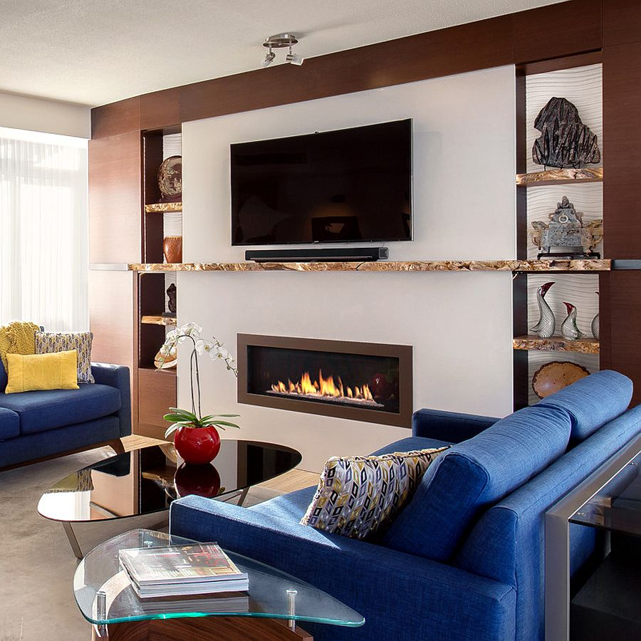 Live edge shelves and mantle transform this contemporary living room [Design: Live Edge Design]