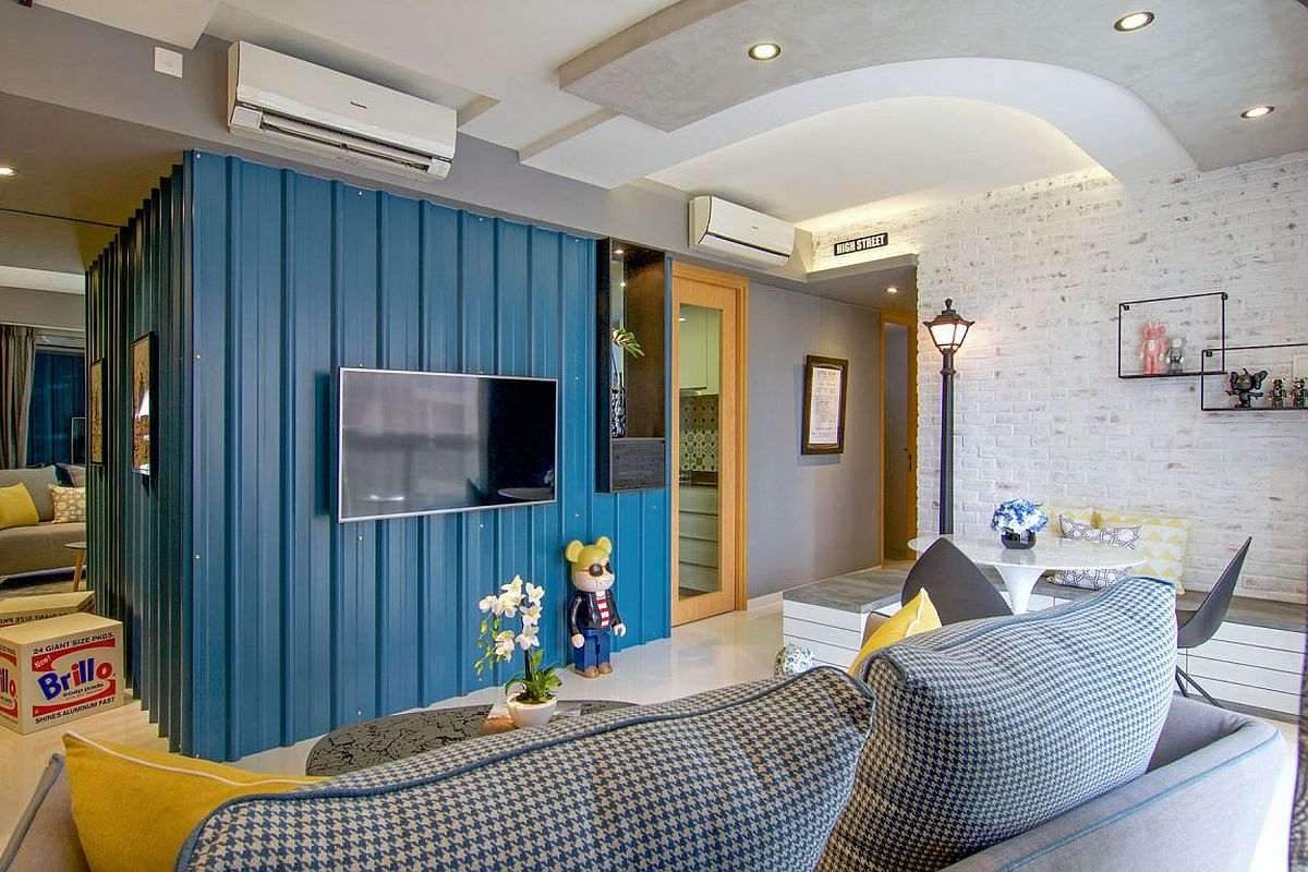 Living room of the cool apartment in Singapore recreates a whimsical street vibe