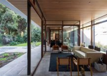 Living-room-with-glass-walls-next-to-the-garden-217x155