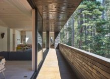 Long open balcony of the beautiful cabin offers lovely views and brings sunlight indoors