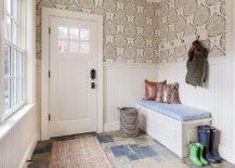 Lotus wallpaper adds interesting and unique motif to the small entrance hall