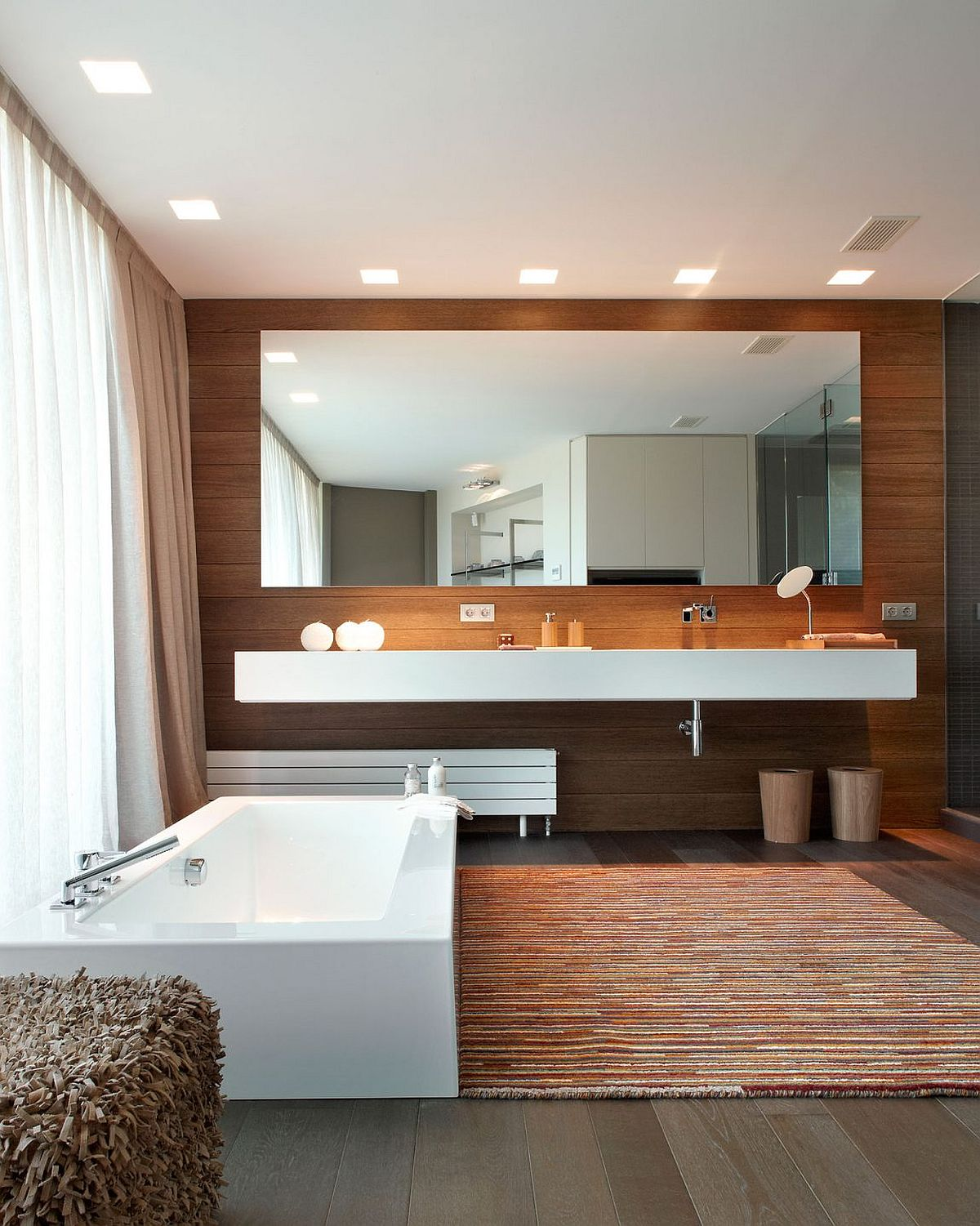 Luxurious modren bathroom with a wooden vanity wall