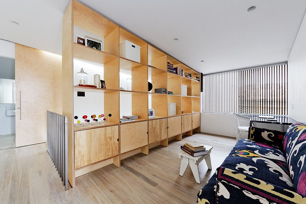 Make the most out of your room divider by using it as a display and storage unit [Design: Join Constructions / Andrew Benn]