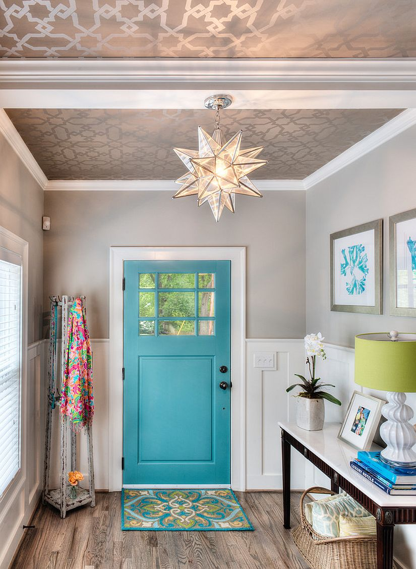 Metallic wallpaper on the ceiling and a splash of blue aim to bring Mediterranean charm to this modern entryway [Design: In Site Designs]